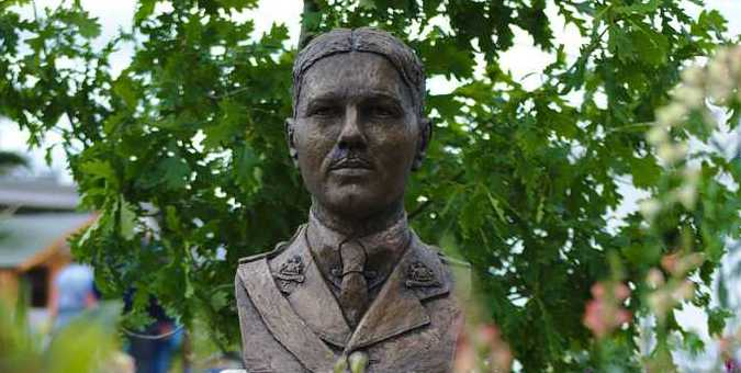 bust of WIlfred owen in a garden